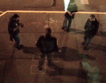 Guys playing hopscotch on a Saturday night in Madison